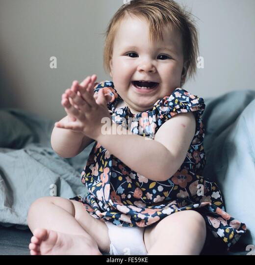 Baby Girl Laughing - Stock Image