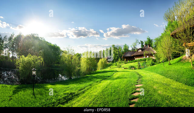 Houses of log and landscape in the morning - Stock Image