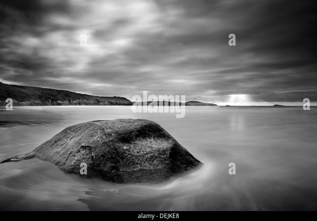 Stone in sea at Whitesands - Stock Image