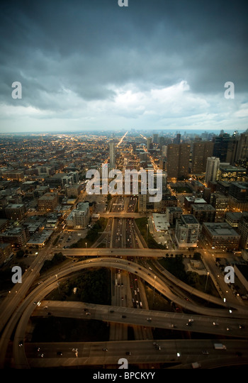 Aerial photograph of network of highways / roads in dark stormy weather - Stock-Bilder