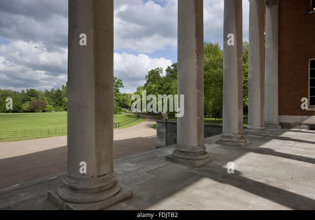 The view through the columns of the 'transparent' portico on the east front of the house, over the park - Stock-Bilder