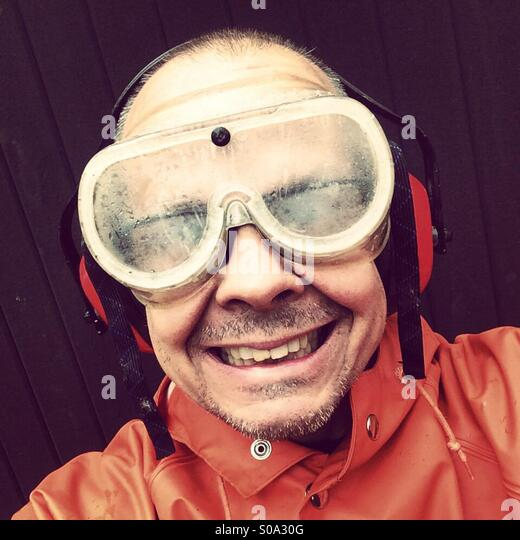 Man i big goggles for protection of eyes - Stock Image