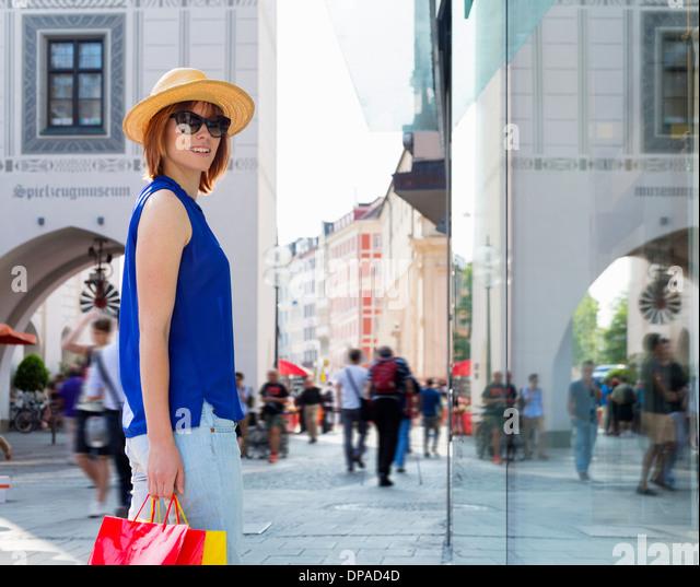 Female tourist in Munich Marienplatz, Munich, Germany - Stock Image