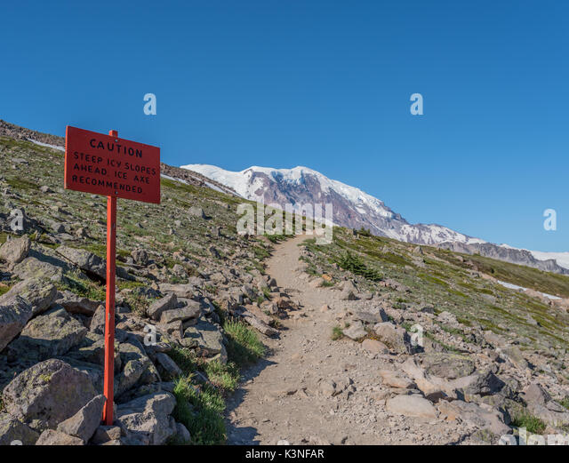 Ice Axe Recommended Sign on slope ascending to Muir Camp - Stock Image