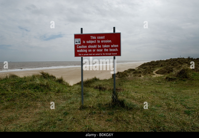 Britain uk England Coastal Erosion erosion Beach Sea Global warming Winterton on Sea Erosion sign Sand Dunes Norfolk - Stock Image