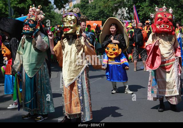 Germany Berlin Carnival of Cultures mongolians wearing masks - Stock-Bilder