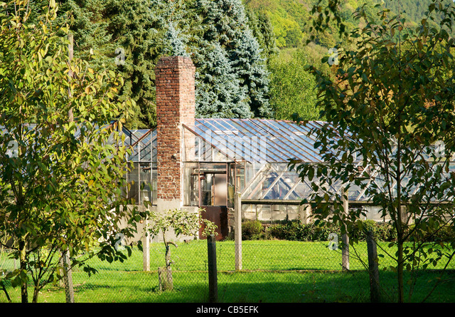 Old deserted greenhouses of a nursery in Heimbach in the valley of the river Rur. - Stock Image