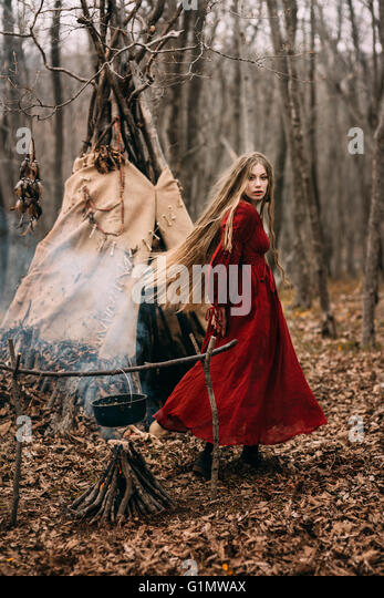 Young witch in the autumn forest - Stock-Bilder