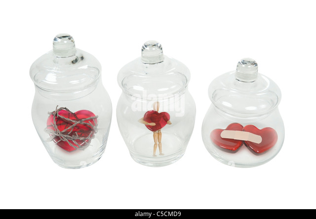 Apothecary jars full of a variety of love potions - Stock Image