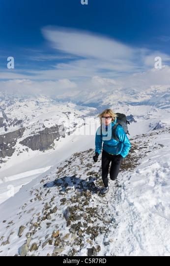 A women jogging on high Alpine mountains. - Stock-Bilder