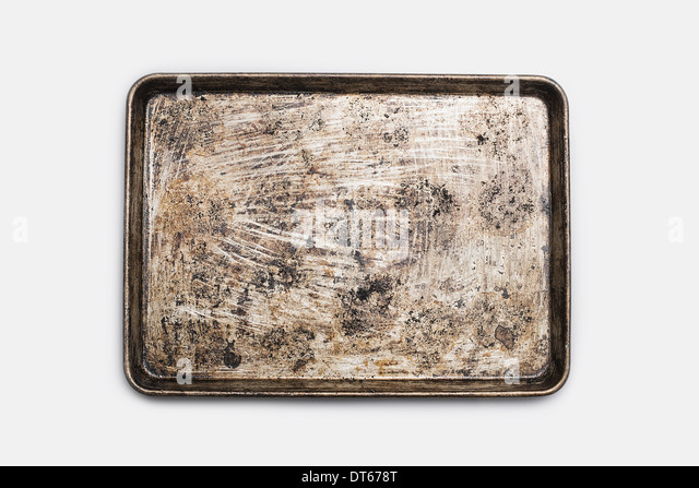 A well used, seasoned baking tray. Cookware. Baking sheet. - Stock Image