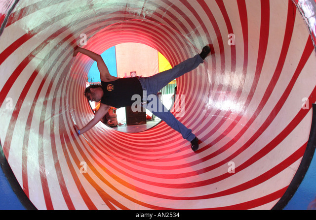Albuquerque New Mexico State Fair carnival midway optical illusion rotating tube W - Stock Image