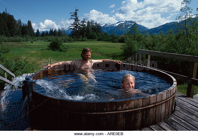 Alaska Stikine River Valley Chief Shake's Hot Springs family hot tub Mt. Flemer beyond - Stock Image