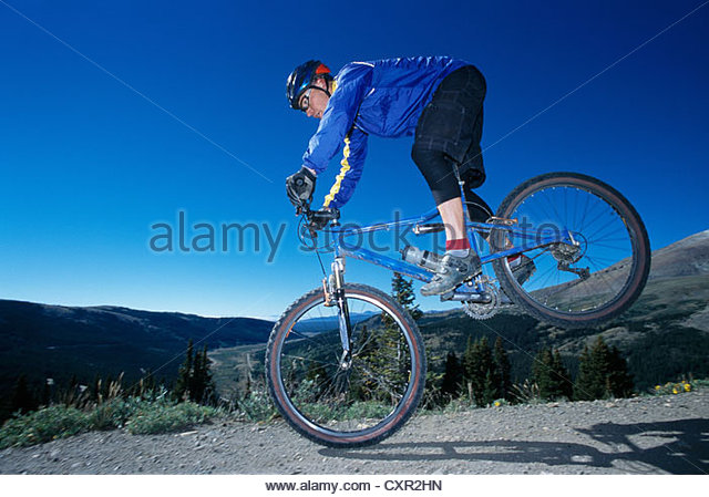 Mountain biker in action, Breckenridge, Colorado, USA - Stock Image