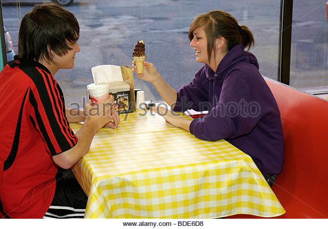 Michigan Chesaning The Malt Shop booth checkerboard tablecloth boy girl teen youth couple ice cream cone milkshake - Stock Image