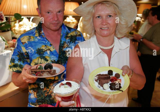 Puerto Rico Atlantic Ocean Holland America Line ms Noordam Lido Restaurant Chocolate Extravaganza dessert couple - Stock Image