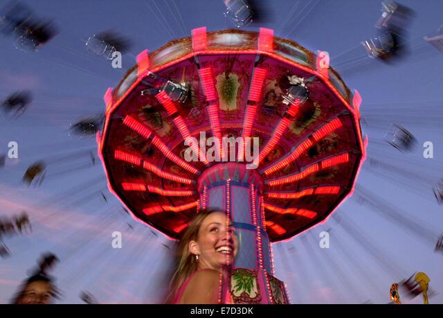 Jun 28, 2001; Pleasanton, CA, USA; Nicole Carvahal 18, of Pleasanton, Calif.,  has fun at the carnival midway as - Stock Image