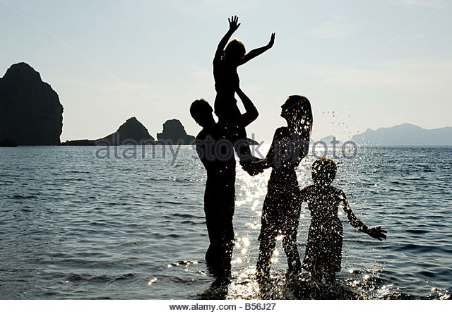 Family in the sea - Stock Image