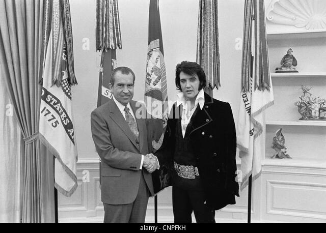Elvis Presley poses for a photo with US President Richard M. Nixon in the Oval Office at the White House December - Stock Image