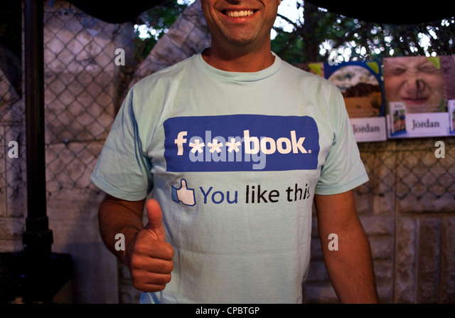 A smiling man with a facebook t-shirt in Amman, Jordan - Stock Image