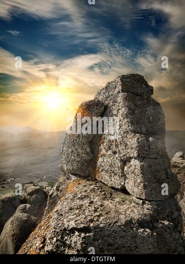 Landscape with rock in mountains at sunset - Stock Image