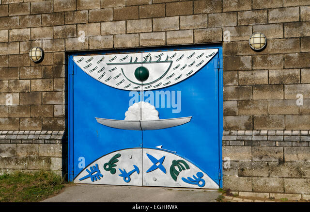 Building with artistically painted doors, Swansea Waterfront, South Wales, UK. - Stock-Bilder