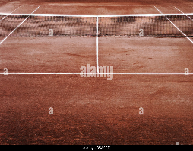 Net On Clay Tennis Court Elevated View - Stock Image