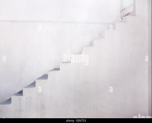 A flight of white stairs against a white background, Oia, Santorini (Thera), Greece - Stock Image