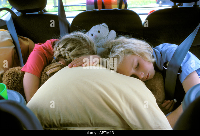 Two girls sleeping in the car - Stock-Bilder
