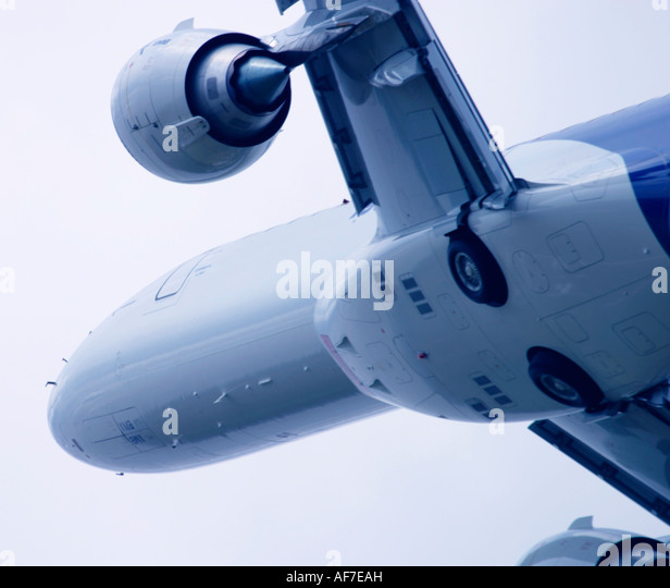Aeroplane flying close up - Stock Image