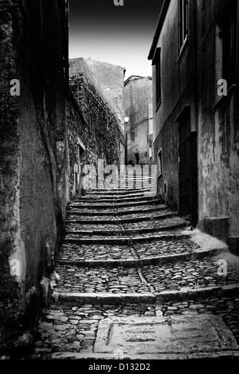 Narrow cobblestone stairs illuminated by moonlight - Stock Image