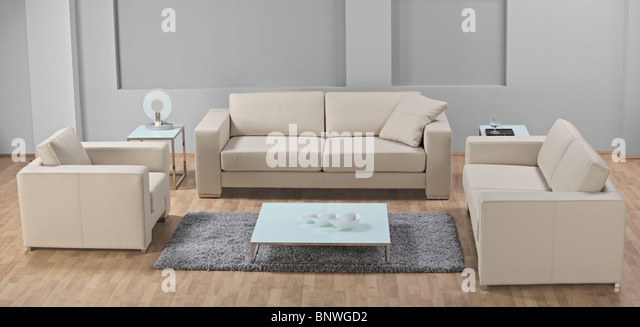 A modern minimalist living-room with white leather furniture - Stock Image