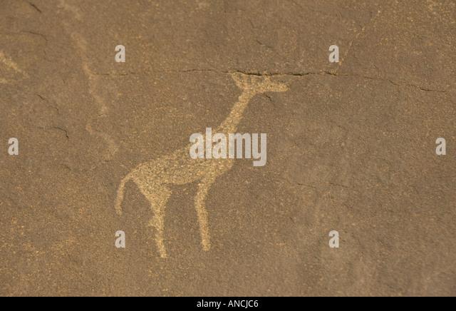 Archaeology Petroglyphs Bushman Rock Paintings at Twyfelfontain Namibia - Stock Image