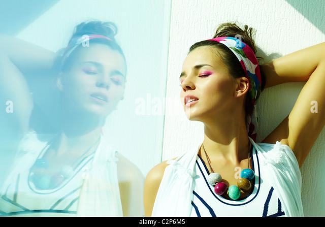 Beautiful woman enjoying daylight - Stock Image