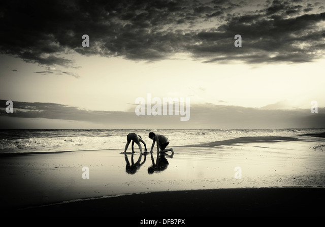 Children playing on the beach - Stock-Bilder