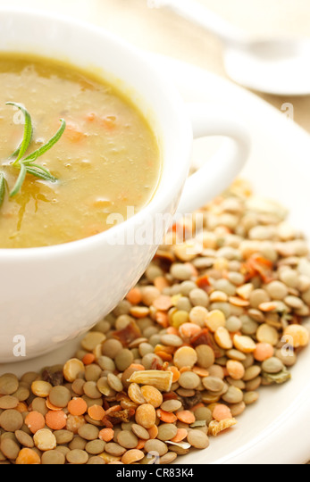 Hot Bowl of Lentil Soup with Dried Lentils for Decoration - Stock Image