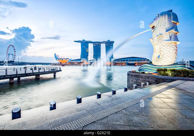 Singapore landmark skyline with sunrise. - Stock Image