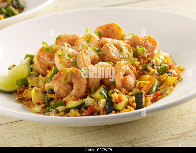 Spicy shrimp with vegetables and Spanish rice - Stock Image