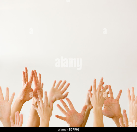 Assorted hands reaching up - Stock Image