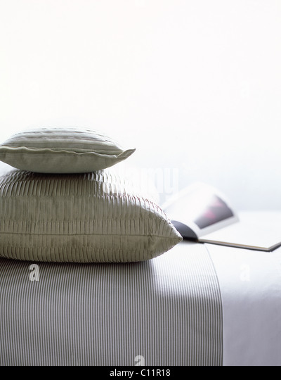 Bed with Pillows and Magazine - Stock Image