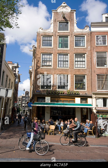 Amsterdam street cafe near Spui bicycles - Stock Image