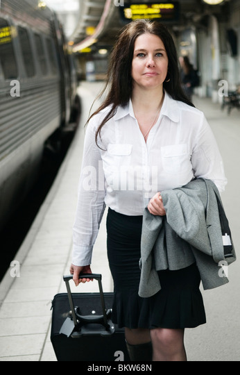 Female traveler on the go - Stock-Bilder