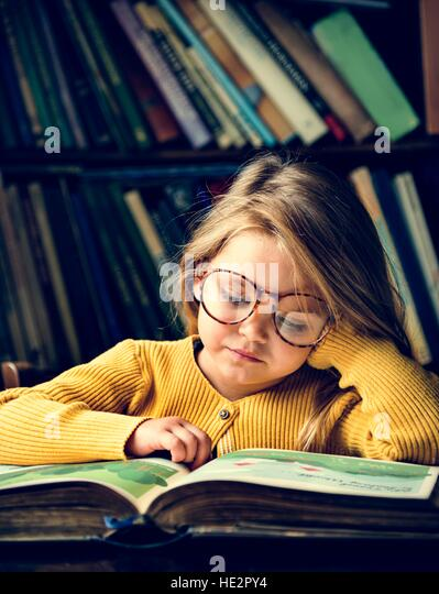 Adorable Cute Girl Reading Storytelling Concept - Stock Image