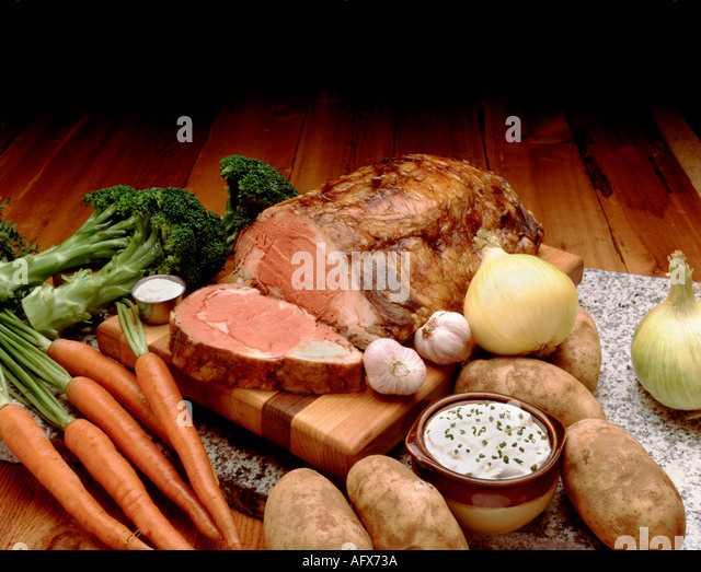 prime rib and vegetables, food on table - Stock Image