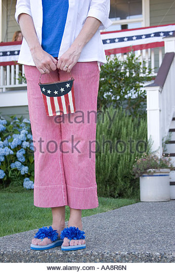 Middle-aged woman holding patriotic bucket - Stock-Bilder