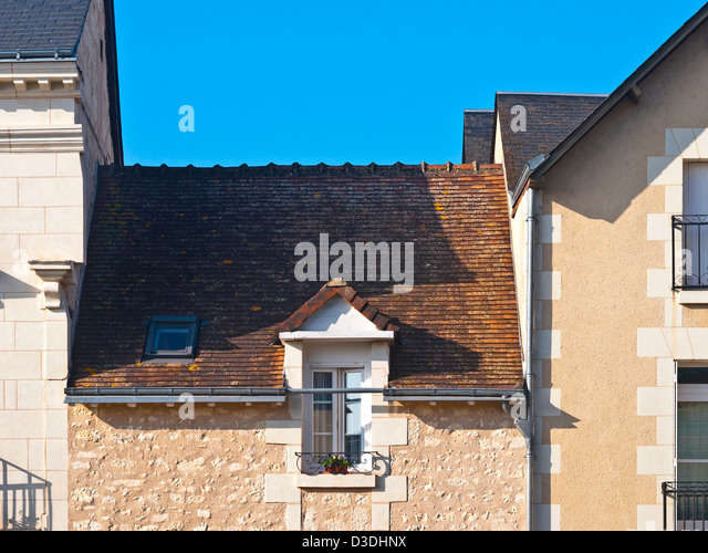 Gap between houses / low roof - France. - Stock Image