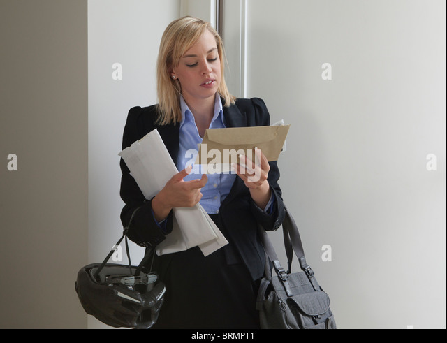 Woman looking at letters - Stock Image