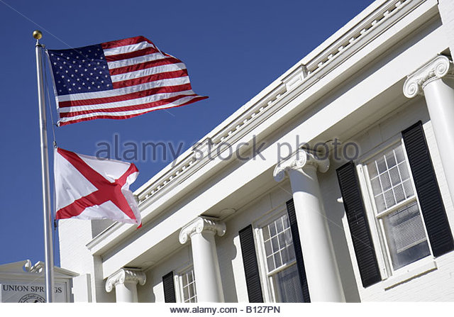 Alabama Union Springs Prairie Street City Hall local government flag Doric columns white building - Stock Image