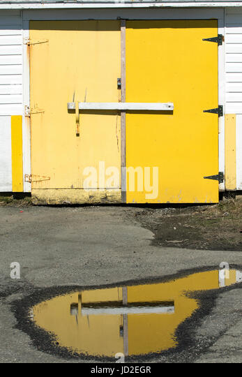 Yellow doors of building in Twillingate Harbour - Twillingate, Newfoundland, Canada - Stock Image