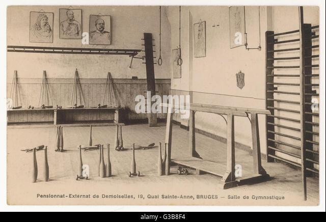 Equipment for gymnastics at a  Belgian girls' school.         Date: circa 1900 - Stock Image